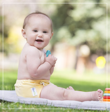 A baby wearing a diaper cover bought at Babies in Bloom
